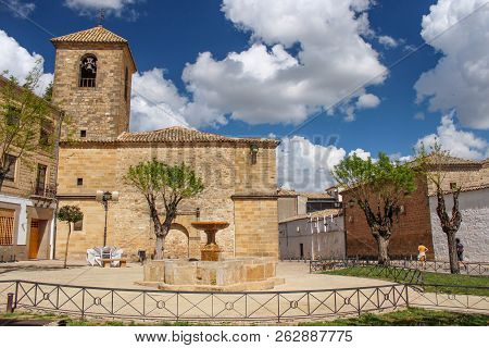 Courtyard In Front Of The Church Of San Pedro (iglesia De San Pedro) With A Water Fountain In The Ce