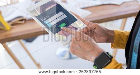 Login page against fashion designer using digital tablet in office