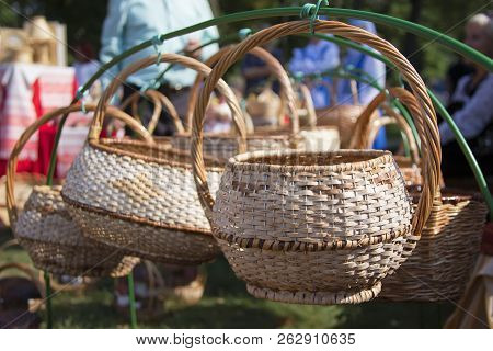 Handmade Baskets Of Birch Bark.a Wickerwork Knitted From A Rod Hangs On A Wire Called A Basket