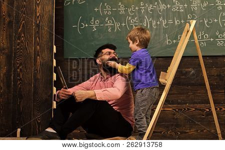 Informal Education Concept. Kid Playing With Mustache Of Dad Or Teacher. Having Fun At The Lesson.