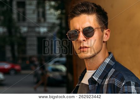 Close-up Of A Man Whish Sunglasses, Male Portrait. Close Up Shot Of Young Man On Country.caucasian M