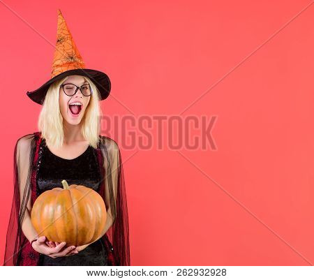 Winking Sexy Witch In Glasses With Magic Pumpkin. Happy Halloween Witch With Jack-o-lantern. Hallowe