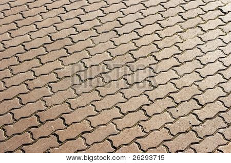 angled pattern of small gray pavement stones