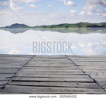 Wood Pedestrian Walkway In The Park.under The Background Of Blue Sky White Clouds.