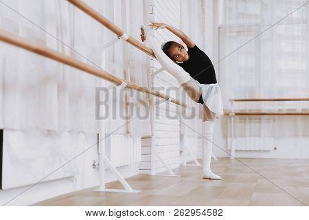 Ballet Training Of Young Girl In Balerina Tutu. Classical Ballet. Training Indoor. Cute Dancer. Perf