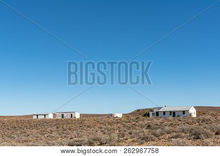 Ceres, South Africa, August 8, 2018: Farm Landscape With Houses On Road R356 In The Western Cape Pro