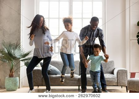 Happy Black African Family Dancing At Home