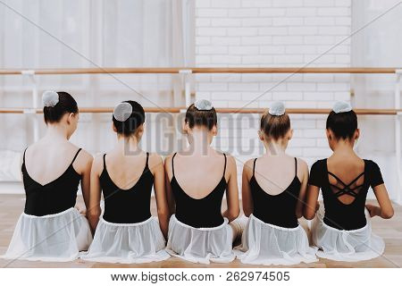 Young Girls Resting After Ballet Training Indoor. Classical Ballet. Girl In Balerina Tutu. Training