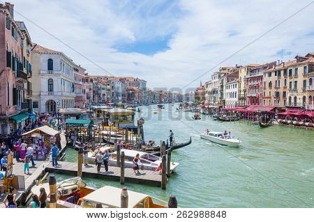 Venice, Italy - June 16, 2014: The View On Grand Canal Daytime Lifestyle From Rialto Bridge. The Ria