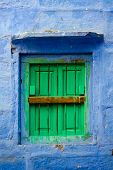 Blue wall and green shutters - Jodhpur Rajasthan India poster