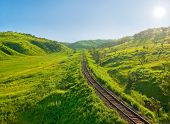 old railway track on the morning hills landscape poster