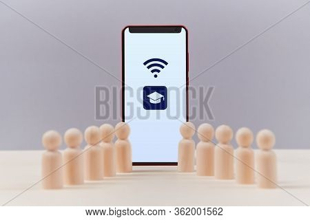 Online Education. E-learning. Distance Learning. Wooden Figures Of Students Near Screen Of Smartphon