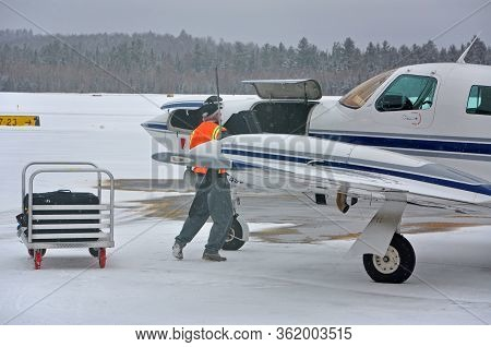 New York State, Usa - Mar. 3, 2013:  Cape Air Cessna 402 At Adirondack Regional Airport Slk In Winte