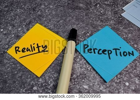 Perception Or Reality Write On A Sticky Note Isolated On The Table.