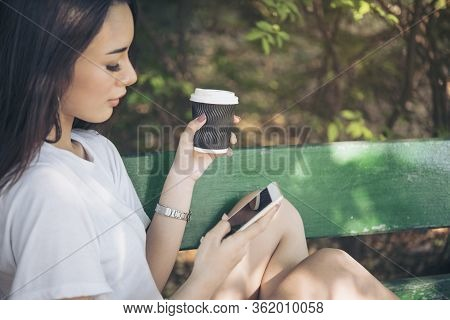Asian Woman Using Phone Shopping Online Website On Smart Tablet Hand Point Touch Screen Digital Tabl