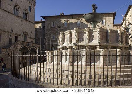 Perugia, Italy - December 10 2016: Fontana Maggiore In Perugia With Palazzo Dei Priori On The Backgr