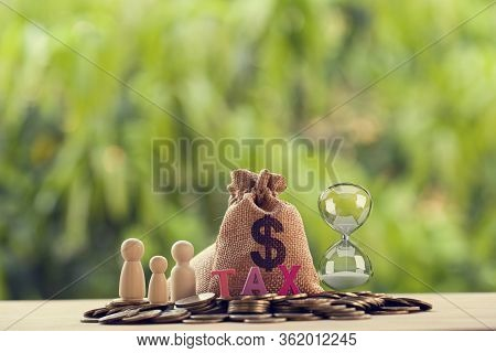 Family Members, Words Tax, Hourglass, Us Money Bags On A Pile Of Coins. Family Tax Benefit, Property