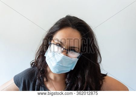 Tired Woman Wearing Black T-shirt, Face Mask And Misted Glasses On White Background