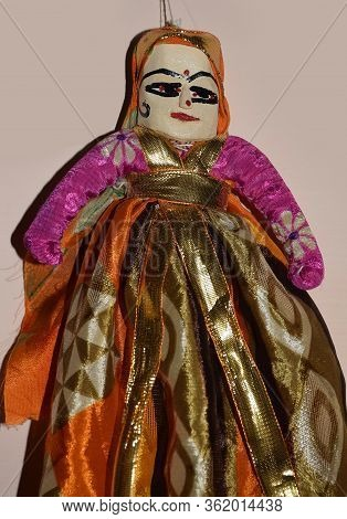 Close Up Of Rajasthani Female Puppet Or Doll Isolated On A Light Background. Puppets In India Are Al