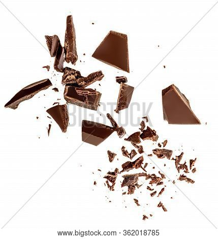 Flying Dark Chocolate Pieces Isolated On White Background.  Chocolate Bar Chunks, Shavings And Cocoa