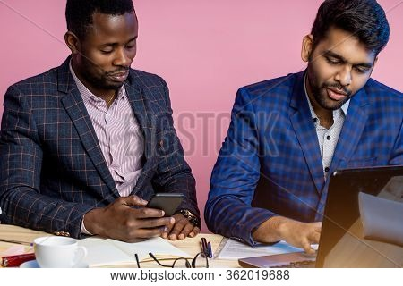 Two Businessmen Speaking And Working At The Office