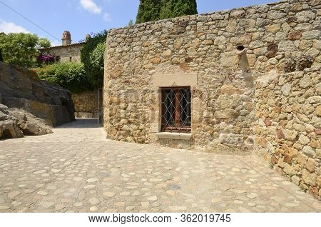 Stone Footpath In The Medieval Village Of Pals, Located In The Middle Of The Emporda Region Of Giron