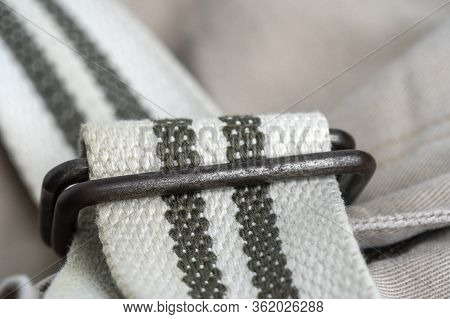 Long Cloth Belt With A Metal Buckle On A Pants, Closeup