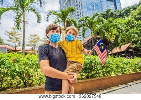 Father And Son Travelers In Medical Mask In Malaysia With Malaysia Flag Celebrating The Malaysia Ind
