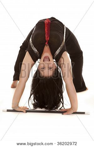 a teen girl in her jazzy outfit doing a back bend with a big smile on her face poster