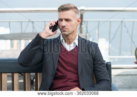 Important Telephone Call. Businessman Talk On Mobile Phone Outdoors. Business Communication. Engagin