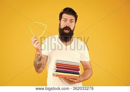 He Needs Luck. Scared Student Hold Books. Bearded Man Prepare For Examination. Read Up For Examinati