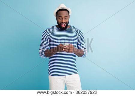 Photo Of Attractive Dark Skin Guy Traveler Good Mood Hold Telephone App Browsing Chatting Friends We