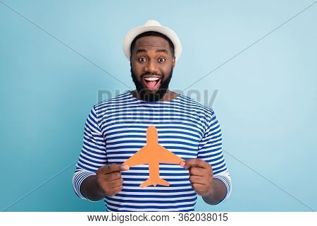 Photo Of Excited Cheerful Dark Skin Guy Traveler Hold Paper Air Plane Win Lottery Free Trip Abroad E