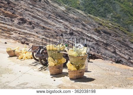 Sulfur Carriers Basket At Kawah Ijen, Indonesia. Heavy Basket Laden By Pieces Of Natural Sulfur To C