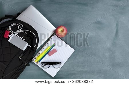 Back To School Concept With Basic Modern Technology And Traditional Educational Objects On Erased Gr