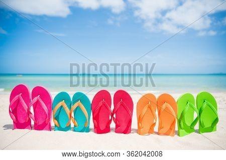 Colorful Flip Flops On The Sandy Beach In Hawaii, Kauai