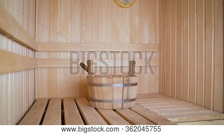 Sauna With A Wooden Basin. Steam Room In A Finnish Bath With A Wooden Basin With Water For Soaking