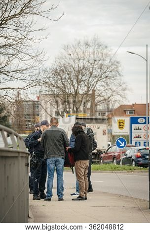 Kehl, Germany - Mar 16, 2020: Square Image Polizei Officers Inspect Travel Permit People At The Bord