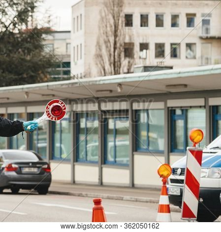 Kehl, Germany - Mar 16, 2020: An Officer Holds Halt Stop Sign Traffic Sign At The Border Crossing In