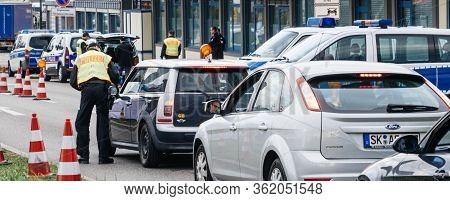 Kehl, Germany - Mar 16, 2020: Wide Image Of Police Officer Inspecting Car At Border Crossing In Kehl