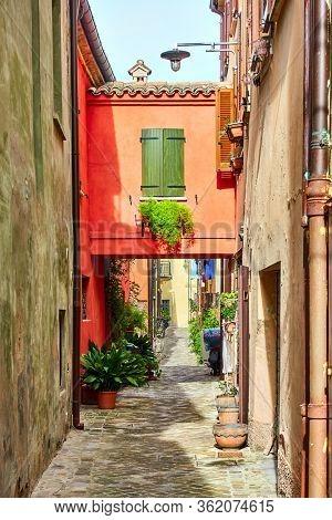 Ancient narrow alley in San Giovanni in Marignano, Italy - Italian cityscape