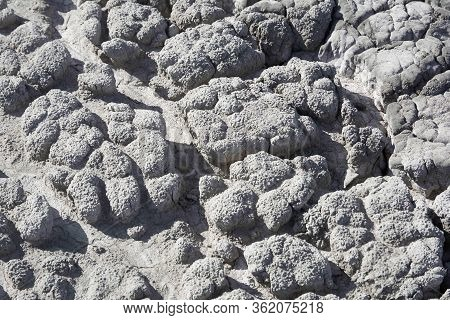 Dry Soil With Deep Cracks. Cracked Mud Surface. Texture Of Cracks On The Ground.