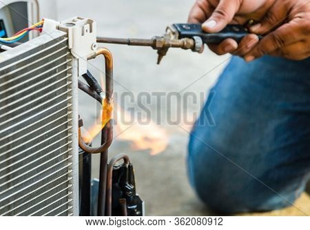 Close Up Of Air Conditioning Repair Use Fuel Gases And Oxygen To Weld Or Cut Metals, Oxy-fuel Weldin