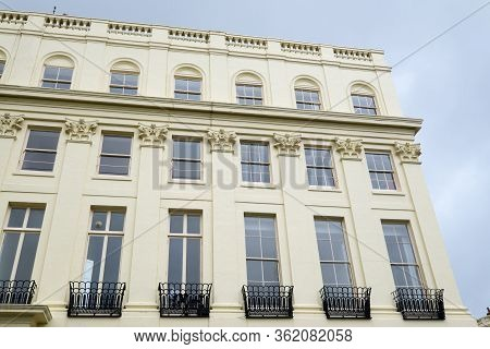 Brighton, Sussex, United Kingdom - March 9, 2020: Regency Architecture Of Building With Balconies Ex