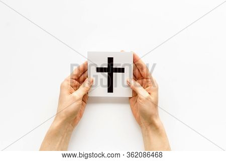 Catholic Cross Sign In Hands - Catholicism Religion Concept - On White Background Top View