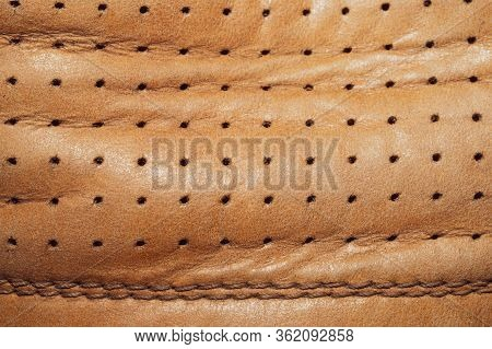 Brown Leather Texture With Holes And Stitches. Creased Material With Seams Macro Background
