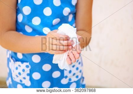 Child Wipes His Hands With Damp Cloth.