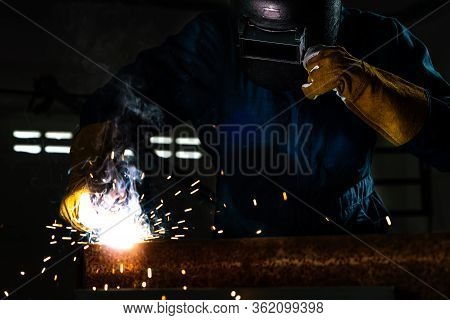 Metal Welder Working With Arc Welding Machine.