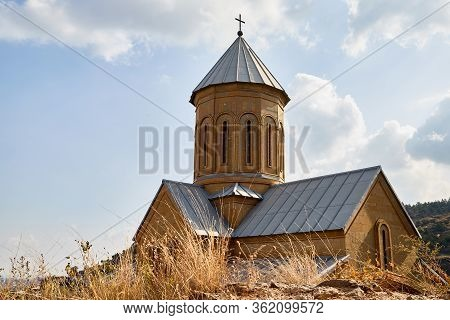 Big Old Chirch In Tbilisi City In Georgia And Blue Sky Background