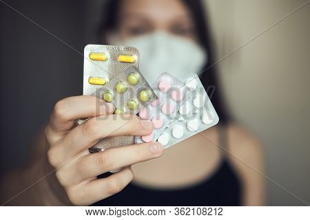 Hand With Colorful Pills In Blisters. Multicolored Pills In Blisters.